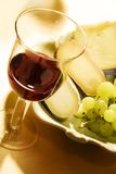 Wine and cheese. Glass of wine with pecorino cheese royalty free stock photos