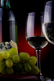 Wine and cheese. A wineglass and cheese on the table Stock Photography