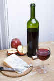 Wine cheese and apples. A healthy snack of red wine cheese and apples on wooden table Royalty Free Stock Photos