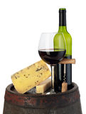 Wine and cheese on barrel Stock Images
