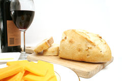 Wine cheese and bread. Isolated photo of wine cheese and bread on white Royalty Free Stock Photography