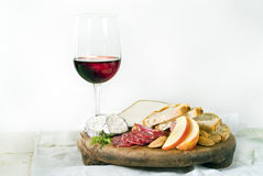 Wine cheese bread and fruits. On white Stock Photos