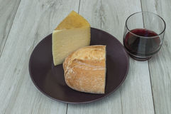 cheese and bread. Wine and cheese bread, bread and cheese on the plate Royalty Free Stock Image