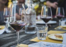 Wine and cheese among friends. Red Wine and a selection of cheeses on a winery Tour in Tuscany stock photos