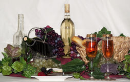Wine with cheese and fruit. Bottles of wine with glasses and grapes and friut and cheese Stock Image