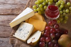Wine, cheese and fruit horizontal top view closeup Royalty Free Stock Photography