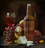 Wine with cheese and fruit. Still-life with red wine and cheese and fruit stock image