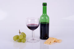 Wine and cheese. Wine in a glass, a bottle of wine and cheese Royalty Free Stock Images