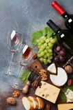 Wine, grape and cheese. Wine, cheese, grape, bread and nuts. Top view with space for your text stock photography