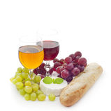 Wine cheese, grapes and baguette Stock Image