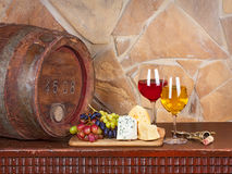Wine, cheese, grapes and old wooden barrel with iron rings Stock Photo