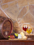 Wine, cheese, grapes and old wooden barrel; still life. Wine, cheese, grapes and old wooden barrel with iron rings; still life Stock Image