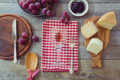 Wine, cheese and grapes on wooden table. View from above stock image