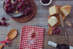 Wine, cheese and grapes on wooden table. View from above Stock Photography