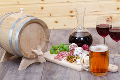 Wine and cheese, meat and fruit. Royalty Free Stock Photography