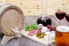 Wine and cheese, meat and fruit. Royalty Free Stock Photo