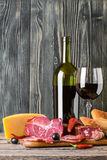 Wine, Cheese and Meat. On a wooden rustic table, food background Stock Photos