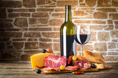 Wine, Cheese and Meat. On a wooden rustic table, food background Stock Photography