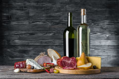 Wine, Cheese and Meat. On a wooden rustic table, food background Stock Image