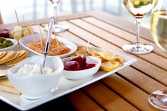 Wine and Cheese on Patio Table. Closeup view of selected wine pairings on a summer patio Stock Photo