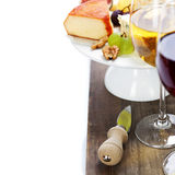 Wine and cheese plate Stock Images