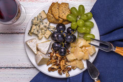 Wine and cheese plate Stock Photos