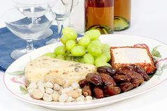 Wine and cheese platter. Fill your favorite platter with cheeses, nuts, dates, and grapes, you are ready for your quests, did you invite them royalty free stock images