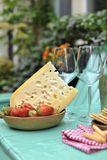 Wine and Cheese. Romantic Lunch Outdoor. Pouring Wine close-up. Outdoors. Copy cpace royalty free stock photos