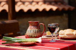 Wine, cheese and saussage on table Stock Photos