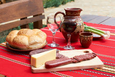 Wine, cheese and saussage on table Stock Images