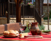 Wine, cheese and saussage on table Royalty Free Stock Image