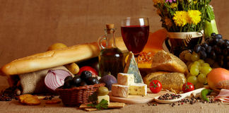 Wine and cheese still life. Composition of cheese, wine, grapes and autumn fruits Royalty Free Stock Photography