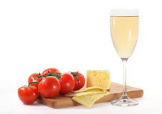 Wine with cheese and tomatoes. Wine with cheese and fresh tomatoes isolated on white Royalty Free Stock Photos