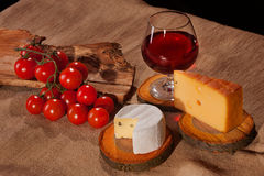 Wine cheese tomatoes Stock Photography