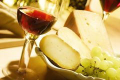 Wine and cheese0. Red wine and italian pecorino cheese royalty free stock photos