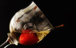 Wine and cherry. Decorated crystal glass of white wine with red cherry Royalty Free Stock Images