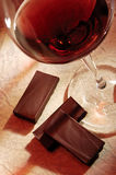 Wine and chocolate. Glass of red wine with chocolate Royalty Free Stock Photo