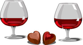 Wine and chocolate. Two glasses of red wine, chocolates with various fillings Royalty Free Stock Photo