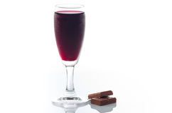 Wine and chocolate. Glass of red wine and two pieces of chocolate isolated on white Stock Photography