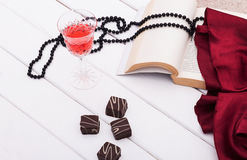 Wine and chocolate. On wood background Royalty Free Stock Photos