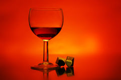 Wine and chocolates. Glass of wine and chocolates with a colorfull background royalty free stock image