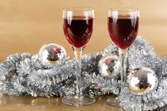 Wine and Christmas decorations. Two glasses of wine with Christmas decoration Royalty Free Stock Photos