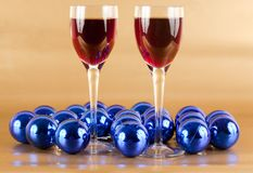 Wine and Christmas decorations. Glasses of wine with Christmas decorations around Stock Photos