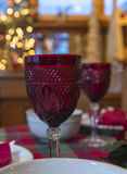 Glassware on a table on Christmas. Wine glass on a table royalty free stock photography