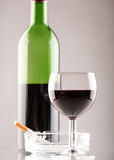 Wine  with cigarette. On the table Stock Photos