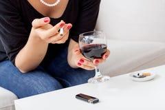 Wine and cigarettes Stock Photo