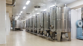 Wine cisterns under temperature control in winery Stock Image