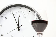 Wine and clock isolated Stock Image
