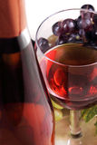 Wine collection: Closeup view of rose wine glass and bottle Royalty Free Stock Images
