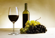 Wine collection: Red Wine glass, wine bottle and grapes Royalty Free Stock Photography